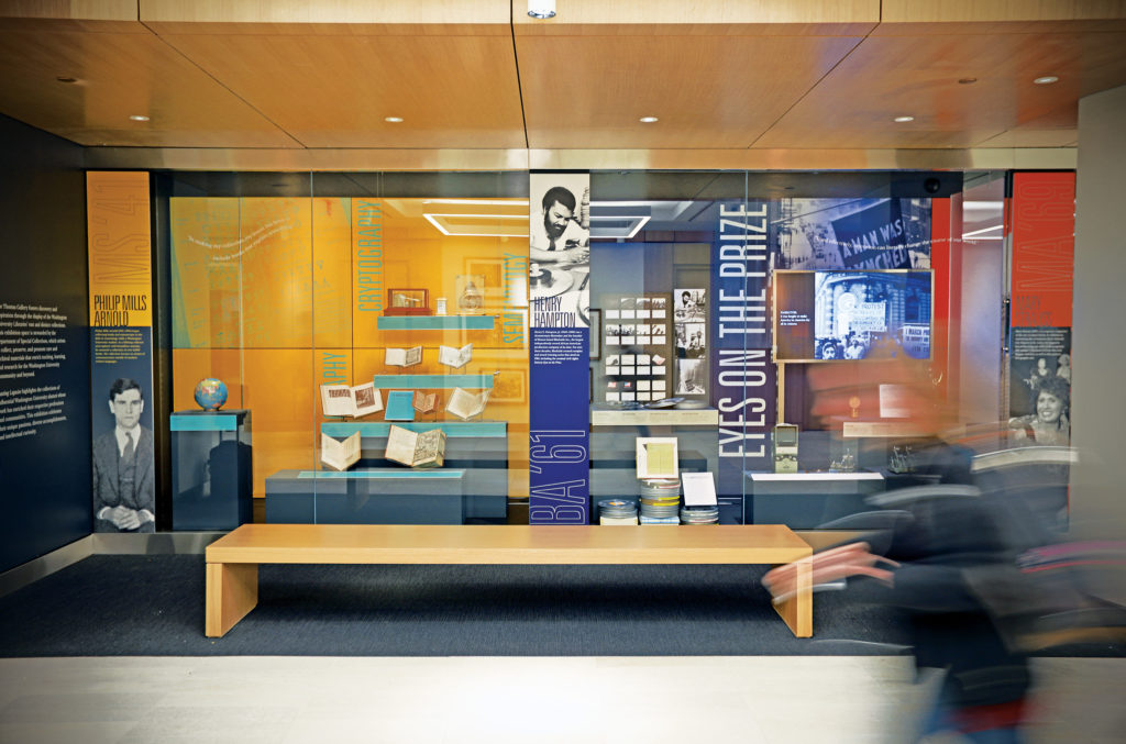 "The Jack E. and Debbie T. Thomas Gallery, located along the corridor that connects the south entrance to the new north entrance, features museum-quality exhibition space and fosters discovery by displaying distinct library collections. The inaugural ­exhibit, ­""Lasting Legacies,"" pays tribute to influential university alumni. (James Byard/Washington University)"