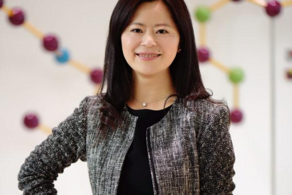 Jo Feng in gray jacket