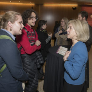 (From left) Students Viktoria Ohstrom and Sam Smith engage Elaine Pagels in a conversation during the reception following the scholar's Assembly Series lecture. (Mary Butkus/WUSTL Photos)
