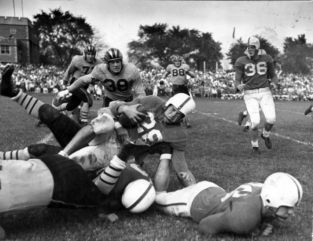 Black and white photo of football tackle