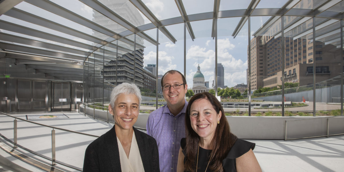 Three alumni — (from left) Anna Leavey, Eric Moraczeswski and Sarah Melinger — work for the Gateway Arch Park Foundation, which joined public and private organizations in a multi-year effort to refurbish the museum and grounds connected to the Gateway Arch. (Joe Angeles/Washington University)