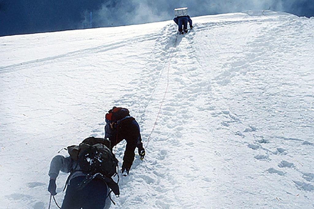 Marcus Raichle climbs a mountain