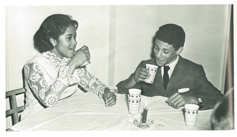 Malcolm Ryder, the first black student to live in The Westminster School's boy's dormitory beginning in the fall of 1968, enjoys a drink with Janice Kemp, one of three black girls who desegregated Westminster in 1967. Image from 1969 Lynx Yearbook, courtesy of Beck Archives-Westminster.