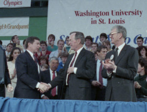 Then Sen. John Ashcroft (left) greets the president on his visit here Feb. 17, 1989, while then Chancellor William H. Danforth looks on.
