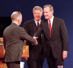 President Bush greets Ross Perot at the 1992 presidential debate held on campus, while candidate Bill Clinton looks on.