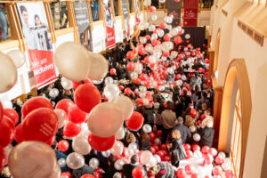 Balloons and banners displayed in Whitaker Hall atrium