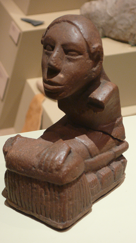 "The Keller figurine, one of several flint-clay statues from the Mississippian mound-building culture unearthed at Cahokia, Ill., is seen by some scholars as 'corn goddess' sitting on rows of corn cobs. Others, such as Gayle Fritz of Washington University in St. Louis, suggest that the figurine is more representative of the ""old mother"" character common among more Souan tribes of the upper Missouri River, such as the Mandan and Hidatsa. Photo by Tim Vickers via Wikipedia Commons."
