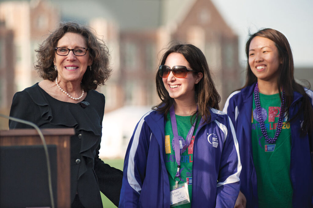 Risa joins students and other members of the community in the annual Relay for Life, a fundraiser for the American Cancer Society. Here she's pictured (far left) at the 2015 event with relay co-chairs Connie Ho (left) and Stephanie Ostroff during the opening ceremonies. Photo by Sid Hastings / WUSTL Photos