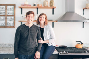 couple in their rehabbed kitchen