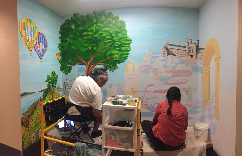 artist paints rodriguez mural