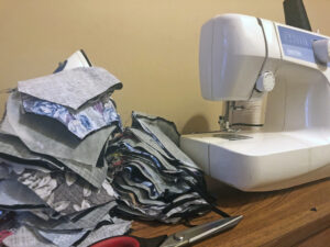 Sewing machine and partially-completed masks