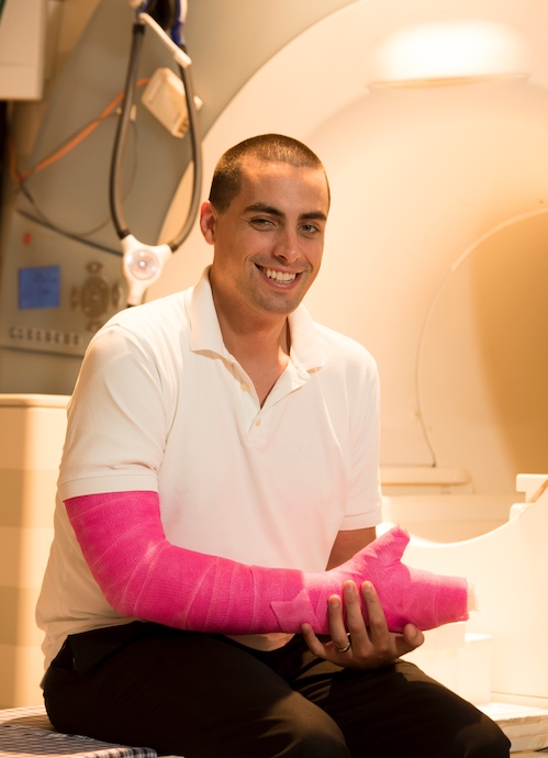 person with hot-pink cast on entire arm and hand