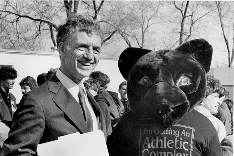 Chancellor Danforth is joined by the Washington University Bear mascot during the Athletic Complex renovation groundbreaking event in 1983.