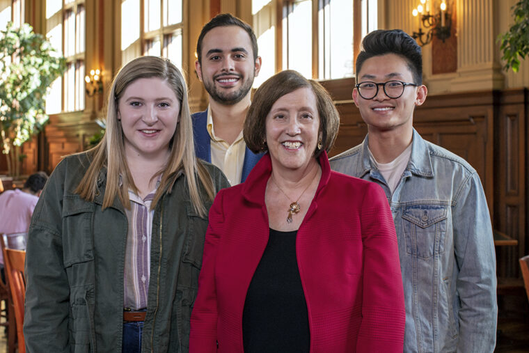A longtime supporter of scholarships in Arts & Sciences and law, Grant (at left) is pictured in early March 2020, prior to any mask mandate, with scholarship recipients (from left) Meghan Street (Arts & Sciences), Ian Herrera (Law) and Max Xu (Arts & Sciences). (Photo: Joe Angeles/Washington University)