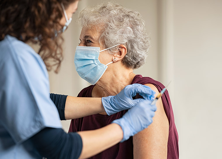 Elderly woman getting a vaccine