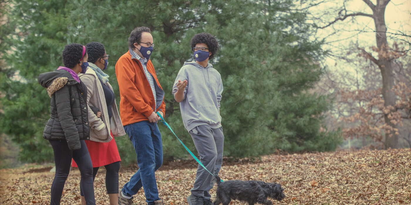 The Nussinov family — (from left) Maya, Tsitsi, Zohar and Ethan — walking their dog, Pi, in Clayton's Oak Knoll Park. (Photo: Joe Angeles/Washington University)