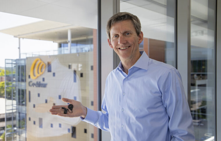 Roger Smith at Cochlear in Australia holding a Cochlear implant