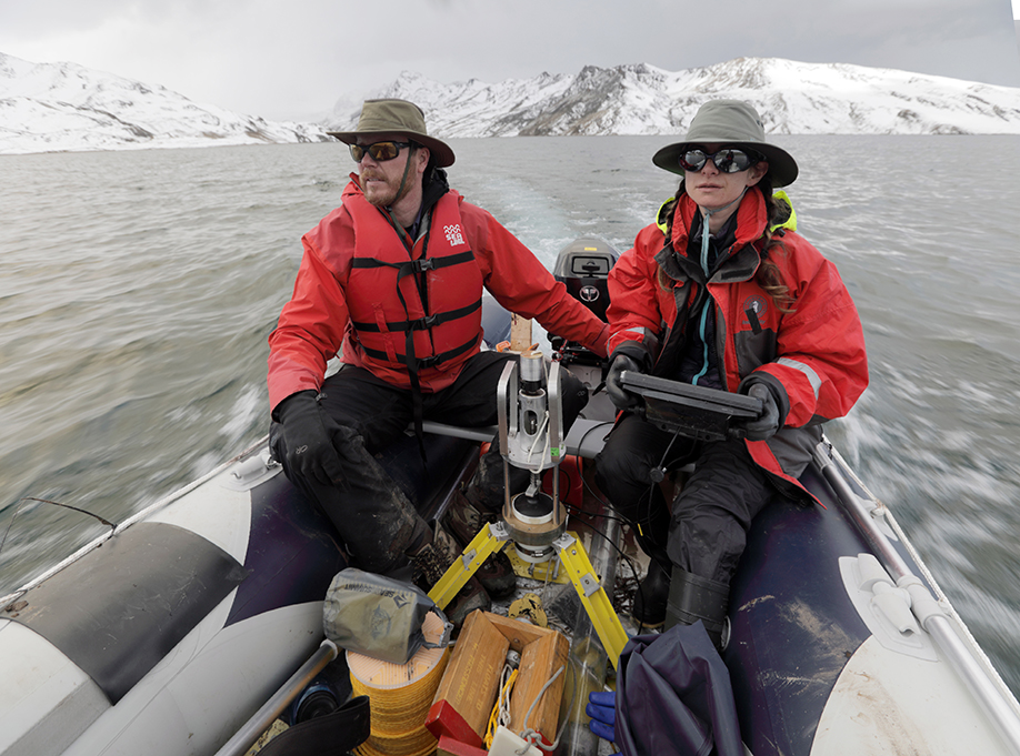 Washington University climate scientist Bronwen Konecky (right) and collaborator Preston Sowell scout sediment coring locations on Lake Sibinacocha using a boat that the research team transported from Cusco. (Photo: Tom Malkowicz)