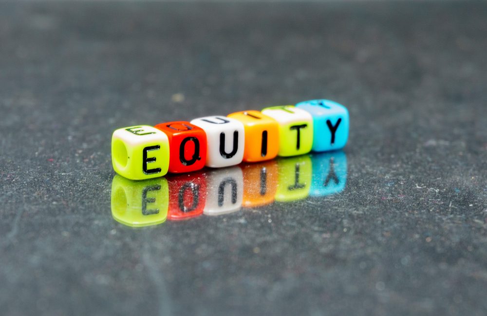 Equity spelled out in beads