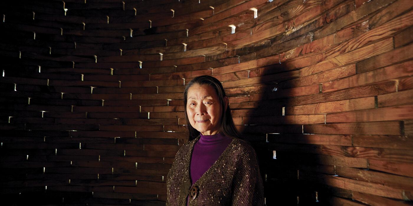 Dianne Chong, inside a sculpture by Taiji Miyasaka called Night Blooming