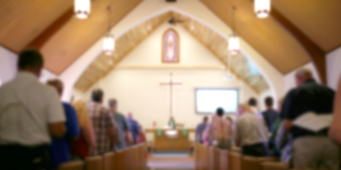 Photo of a congregation in church.