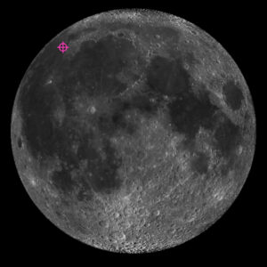 An image of the moon with a pink crosshair showing the Chang'e-5 mission's landing spot to the upper left