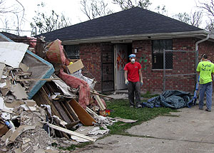 Sophomore Ray Deng (left) and Eric Sinn, brother of WUSTL sophomore Brian Sinn, remove garbage from a house in New Orleans during a spring-break trip to assist victims of Hurricane Katrina.