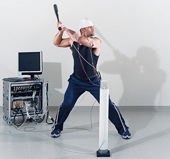 El Hombre vs. The Babe: Pujols swings a bat in the lab of Catherine Lang, assistant professor in physical therapy.
